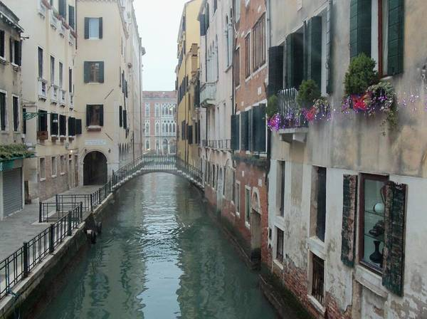 Canals In Venice Poster featuring the photograph Still Waters In Venice Italy by Jan Moore