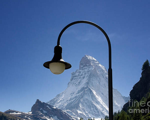 Mountains Poster featuring the photograph Street Lamp And Mountain by Mats Silvan