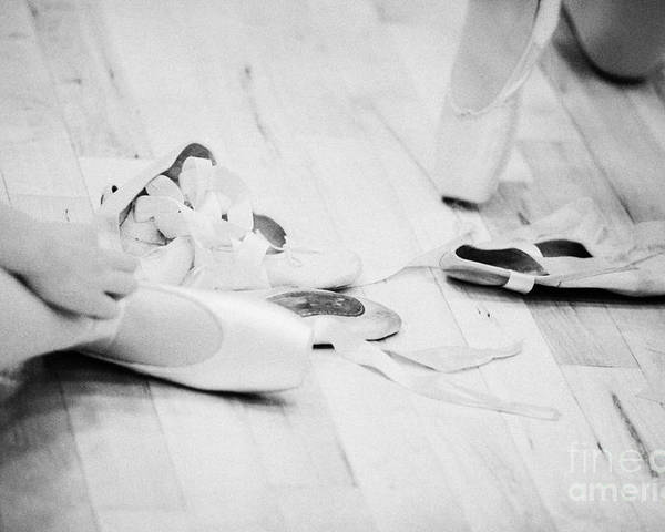 Ballet Poster featuring the photograph Students Putting On Pointe Shoes At A Ballet School In The Uk by Joe Fox