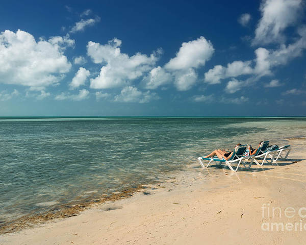 Bahamas Poster featuring the photograph Sunbathers On The Beach by Amy Cicconi