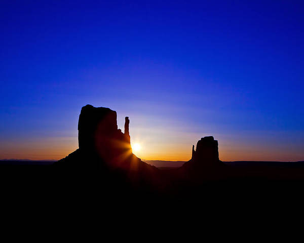 Monument Poster featuring the photograph Sunrise Over Monument Valley by Susan Schmitz