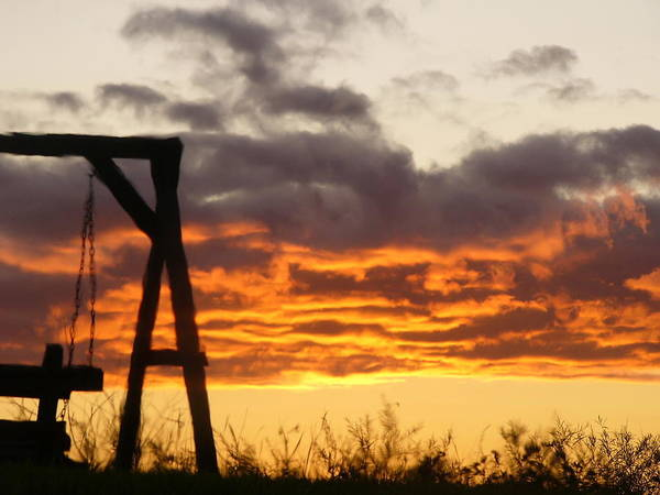 Silhouetted Swing-set Against The Sunset Poster featuring the photograph Sunset Swing by Debra Schultz