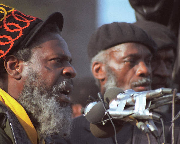 Racism Poster featuring the photograph The Leaders Of A Local Antyracist Movement While Performing Their Speach During Toronto Riots 1992 by T Monticello