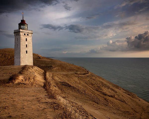 Rubjerg Knude Poster featuring the photograph The Lighthouse by Paul Davis