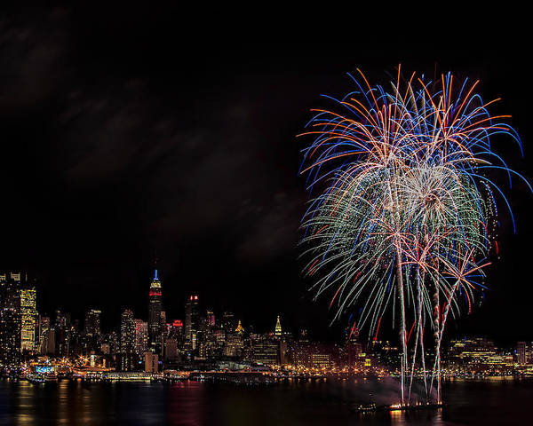 4th Of July Poster featuring the photograph The New York City Skyline Sparkles by Susan Candelario