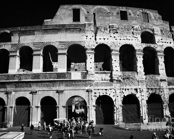 Rome Poster featuring the photograph Tourists Exit The Rear Entrance To The Colosseum Rome Lazio Italy by Joe Fox