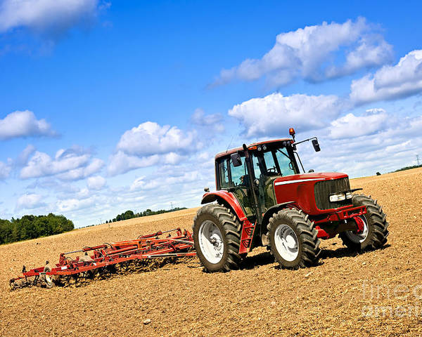 Tractor Poster featuring the photograph Tractor In Plowed Farm Field by Elena Elisseeva