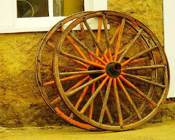 Wheels Poster featuring the photograph Two Wagon Wheels by Jeff Swan