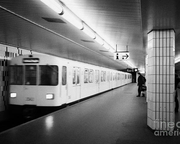 Berlin Poster featuring the photograph u-bahn train pulling in to ubahn station Berlin Germany by Joe Fox
