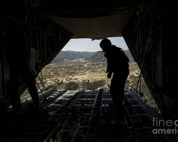 Air Force Poster featuring the photograph U.s. Air Force Airman Pushes by Stocktrek Images