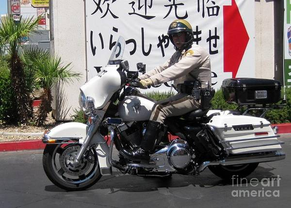 Vegas Motorcycle Cop Poster featuring the photograph Vegas Motorcycle Cop by John Malone