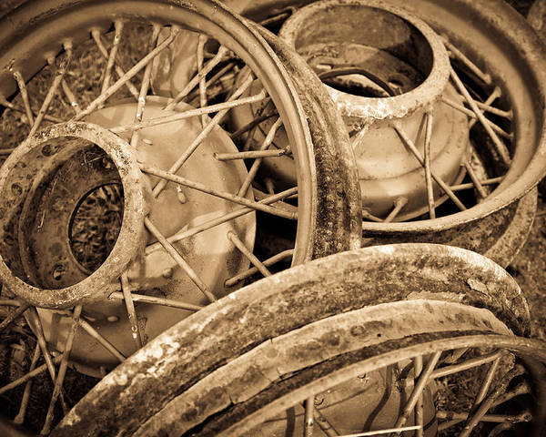 Deserted Poster featuring the photograph Vintage Wire Wheels by Steve McKinzie