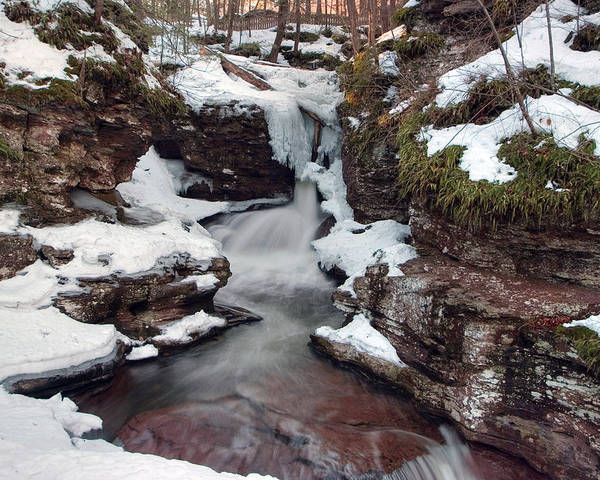 Waterfall Poster featuring the photograph Winter Still Has Its Icy Grip On Adams Falls by Gene Walls
