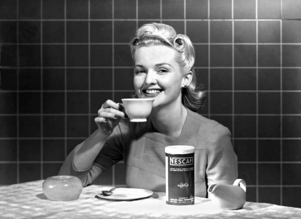 1960 Poster featuring the photograph Woman Drinking Nescafe by Underwood Archives