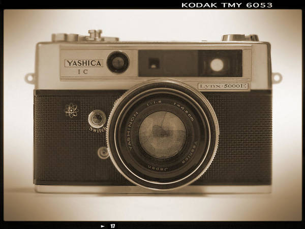 Classic Film Camera Poster featuring the photograph Yashica Lynx 5000e 35mm Camera by Mike McGlothlen