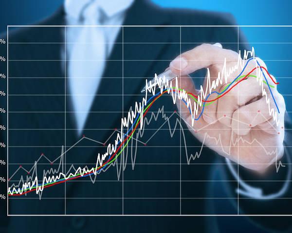Abstract Poster featuring the photograph Businessman Writing Graph Of Stock Market by Setsiri Silapasuwanchai