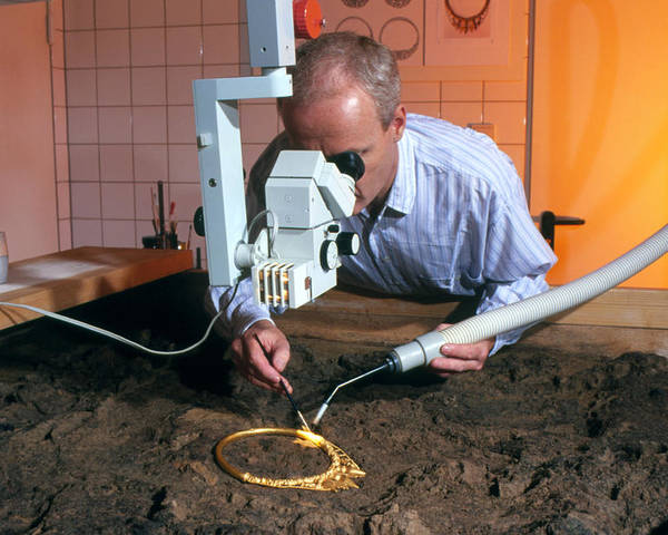 Celtic Necklace Poster featuring the photograph Archaeologist Cleaning A Golden Celtic Necklace by Volker Steger