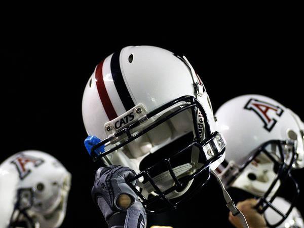 University Of Arizona Poster featuring the photograph Arizona Football Helmets by University of Arizona