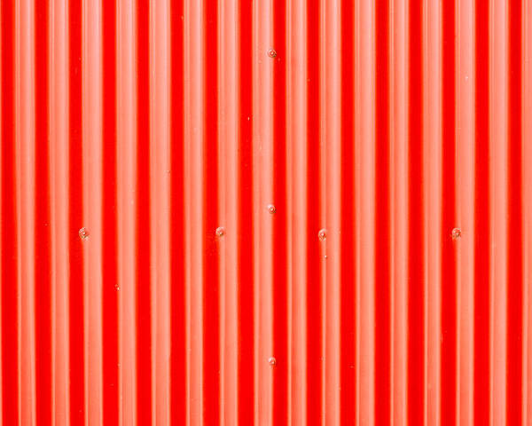 Abstract Poster featuring the photograph Red Corrugated Metal by Tom Gowanlock