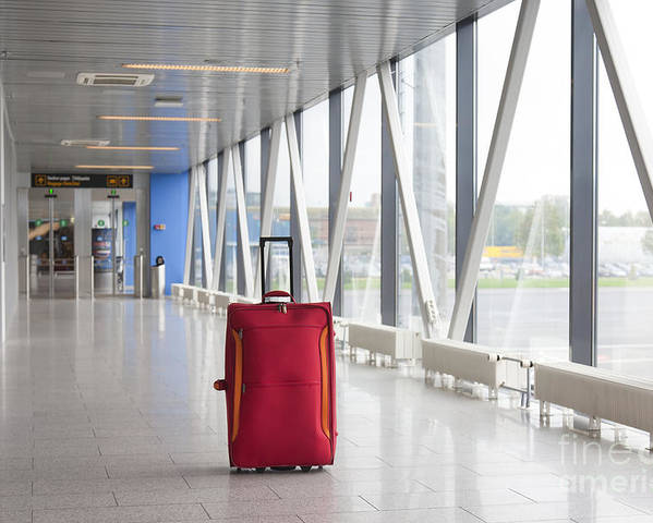 Abandoned Poster featuring the photograph Rolling Luggage In An Airport Concourse by Jaak Nilson