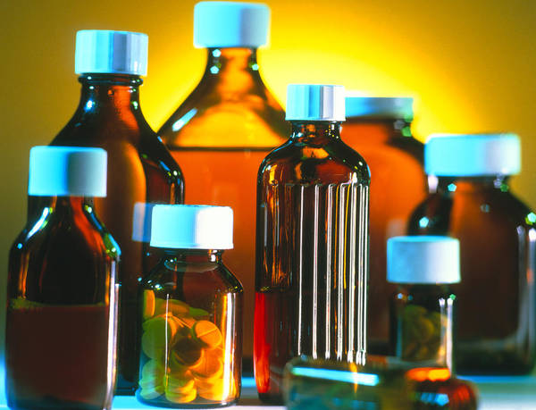 Safety Cap Poster featuring the photograph Collection Of Medicine Bottles With Safety Caps by Tek Image