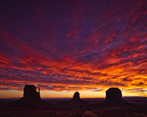 Light Poster featuring the photograph Sunrise Over Monument Valley, Arizona by Robert Postma