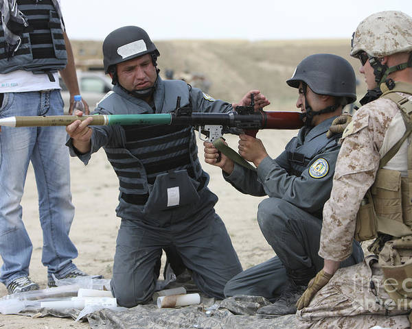 Kunduz Poster featuring the photograph An Afghan Police Student Loads A Rpg-7 by Terry Moore