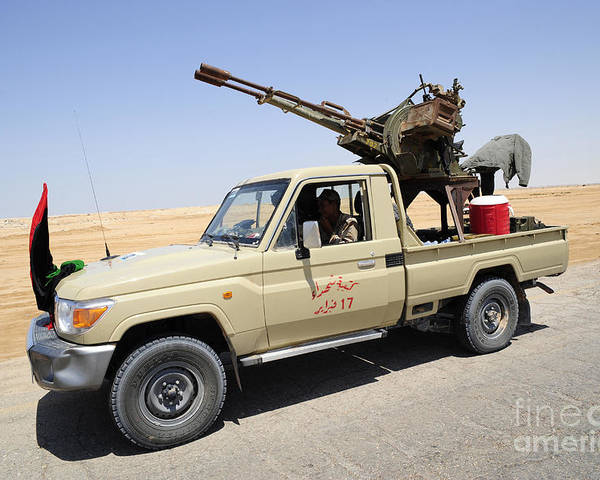 Libya Poster featuring the photograph A Free Libyan Army Pickup Truck by Andrew Chittock