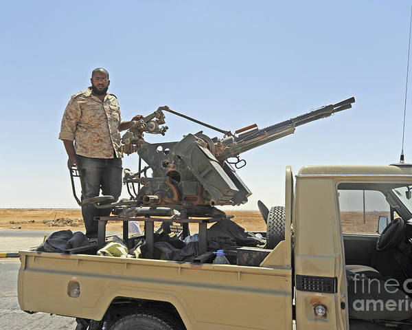 Ajadabiya Poster featuring the photograph A Free Libyan Army Pickup Truck by Andrew Chittock