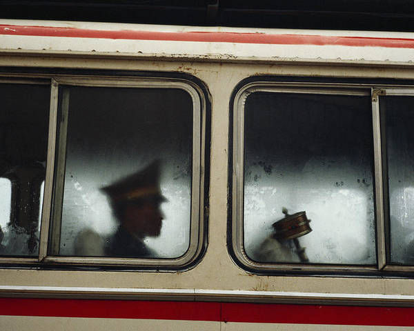 Armed Forces Poster featuring the photograph A Chinese Pla Soldier Sits On A Bus by Justin Guariglia