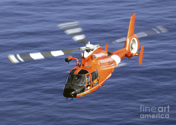 Aircraft Poster featuring the photograph A Coast Guard Hh-65a Dolphin Rescue by Stocktrek Images