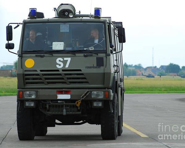 Air Component Poster featuring the photograph A Fire Engine Based At The Air Force by Luc De Jaeger