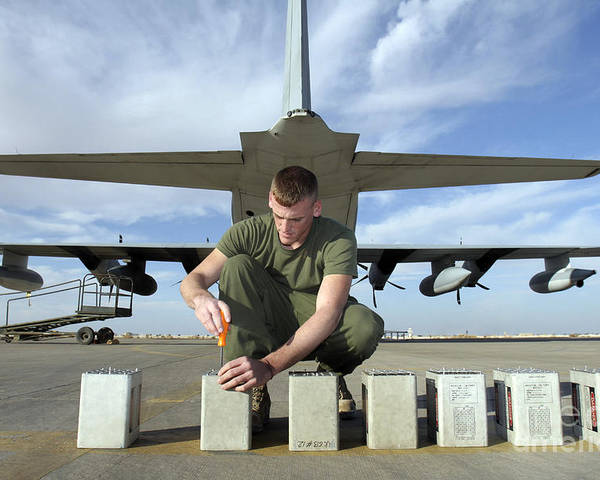 Aircraft Poster featuring the photograph A Marine Replaces Flares In Flare by Stocktrek Images