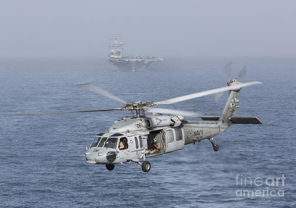 Arabian Sea Poster featuring the photograph A Mh-60s Knighthawk Conducts A Vertical by Gert Kromhout