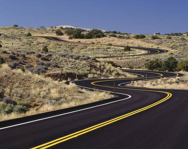 No People Poster featuring the photograph A Newly Paved Winding Road Up A Slight by Greg Probst