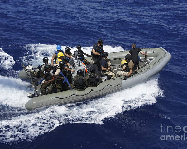 Inflatable Boats Poster featuring the photograph A Rigid-hull Inflatable Boat Carrying by Stocktrek Images
