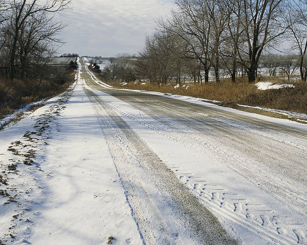 North America Poster featuring the photograph A Snow-covered Road Passes by Joel Sartore
