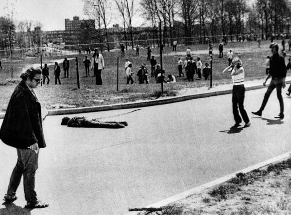 History Poster featuring the photograph A Student Lies Dead At Kent State by Everett