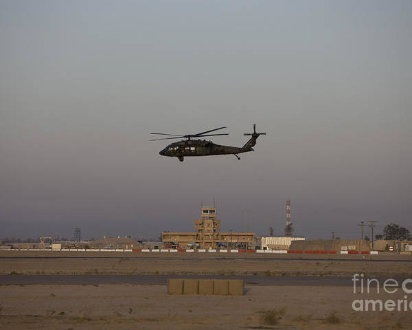 Aircraft Poster featuring the photograph A Uh-60 Blackhawk Helicopter Flies by Terry Moore