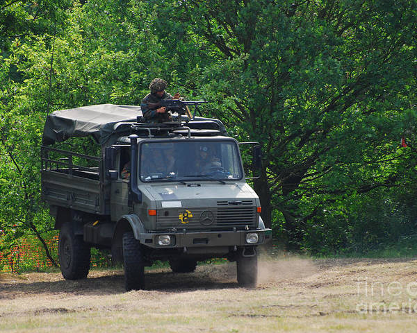 Unimog Poster featuring the photograph A Unimog Vehicle Of The Belgian Army by Luc De Jaeger