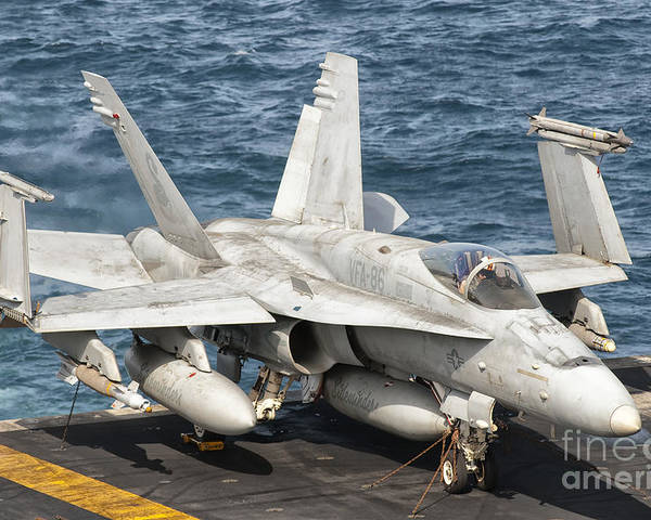Transportation Poster featuring the photograph A Us Navy Fa-18c Hornet Tied by Giovanni Colla