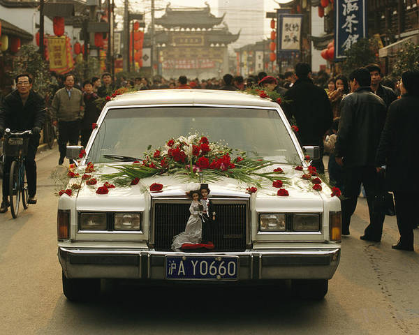 Asia Poster featuring the photograph A Wedding Limousine With Flowers Rolls by Justin Guariglia