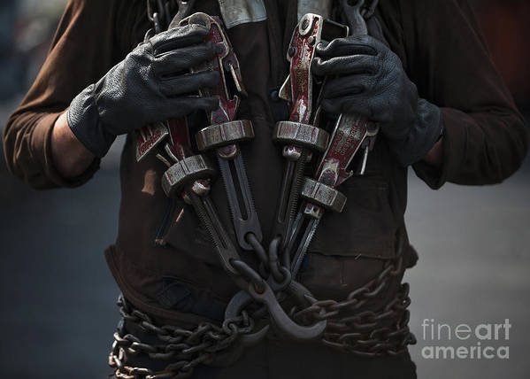 Close-up Poster featuring the photograph Airman Carries Aircraft Tie-down Chains by Stocktrek Images