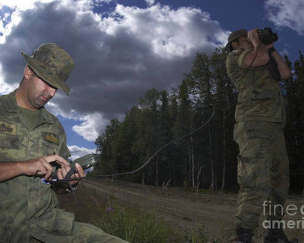 Airmen Poster featuring the photograph Airmen Use A Range Finder And Gps Unit by Stocktrek Images