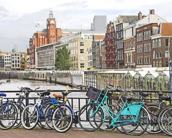 Amsterdam Poster featuring the photograph Amsterdam Canal And Bikes by Giancarlo Liguori