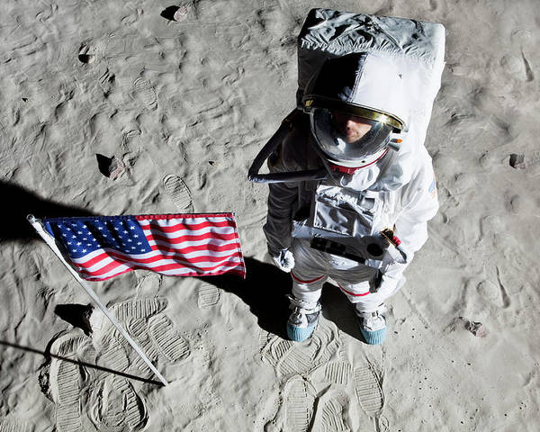 30-34 Years Poster featuring the photograph An Astronaut On The Surface Of The Moon Next To An American Flag by Caspar Benson