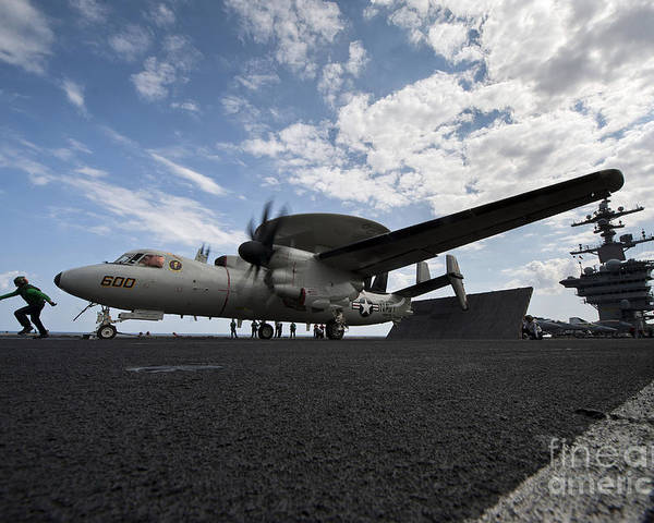 Motioning Poster featuring the photograph An E-2c Hawkeye Aircraft Prepares by Stocktrek Images