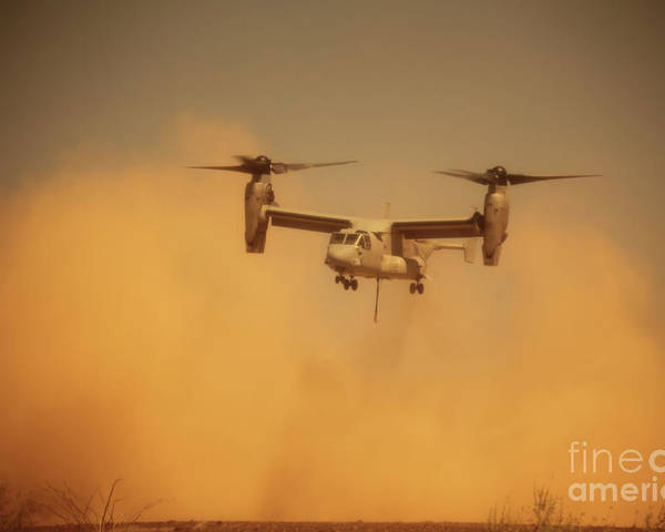 Dust Poster featuring the photograph An Mv-22 Osprey Aircraft Blows Dust by Stocktrek Images