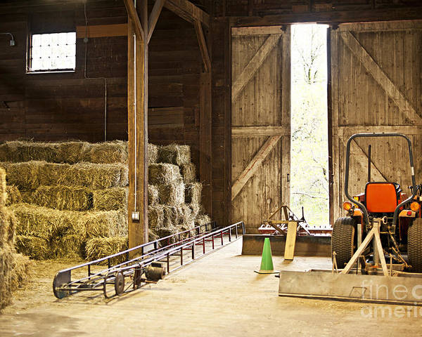 Barn Poster featuring the photograph Barn With Hay Bales And Farm Equipment by Elena Elisseeva