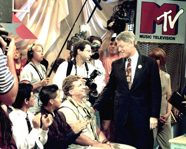 Applauding Poster featuring the photograph Bill Clinton Appears With Young by Everett